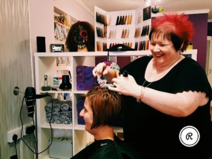 Snip, snip - Suzanne feels content when she is able to impact a customer's life