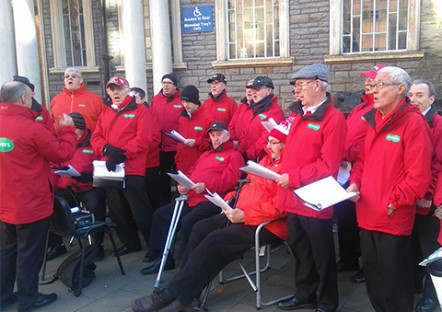 Maesteg Gleeman Male Voice Choir performing outside Maesteg Town Hall on Saturday