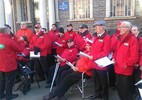 Maesteg Gleeman Male Voice Choir performing outside Maesteg Town Hall on Saturday
