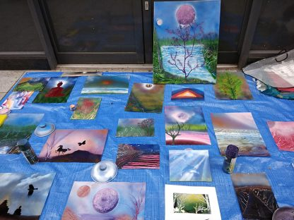 a display of spray paintings on Queen Street