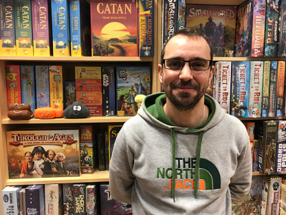 A man stands in a board game shop