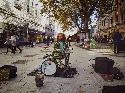 A busker, Cliff Collings, at his drum set on Queen Street