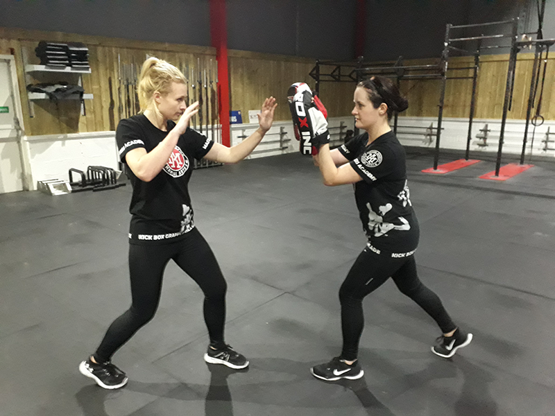 Two women in a fighting stance