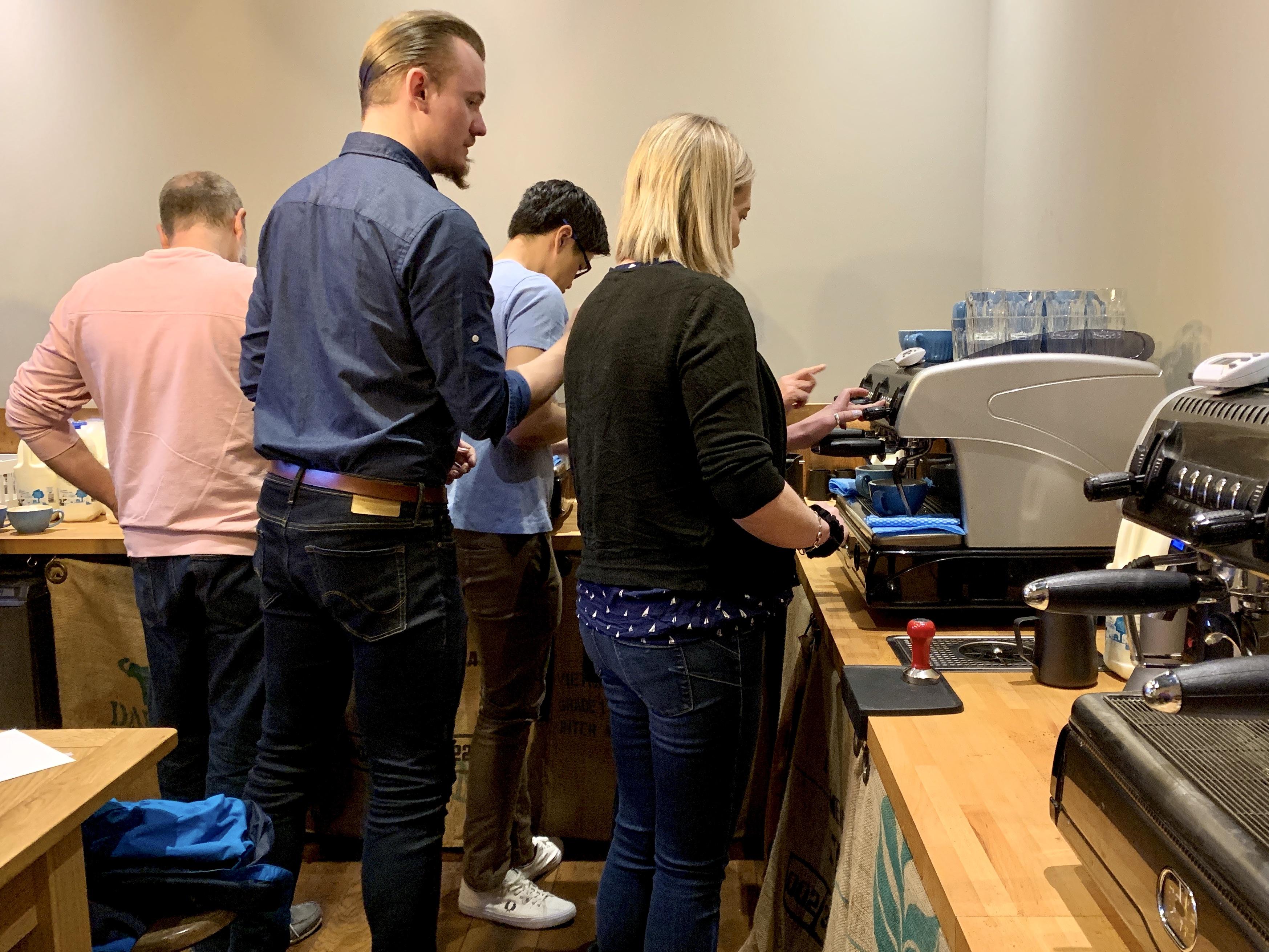 Barista school in progress - people learning to make coffee