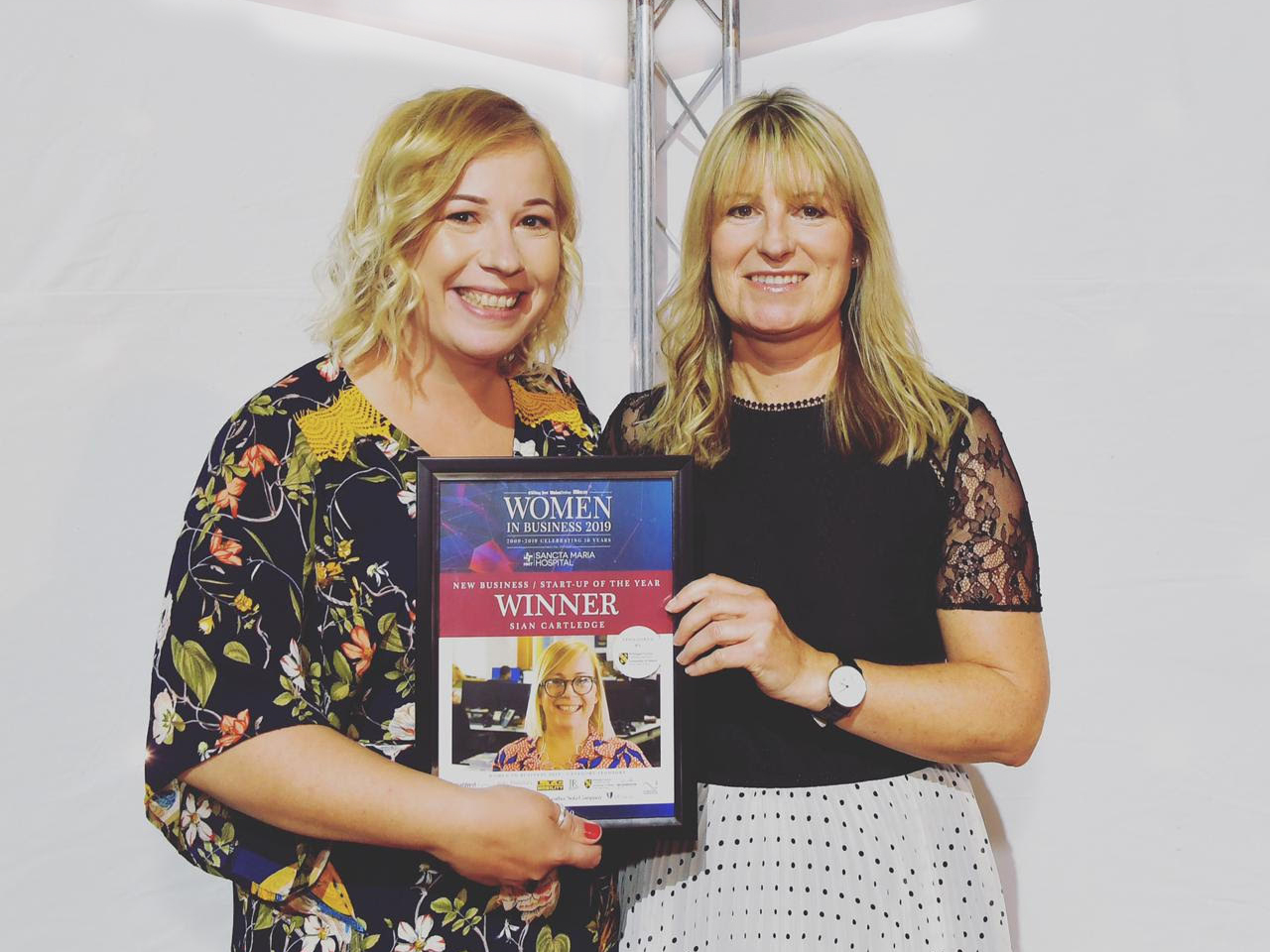 Sian and another woman hold up her Welsh Women in Business award