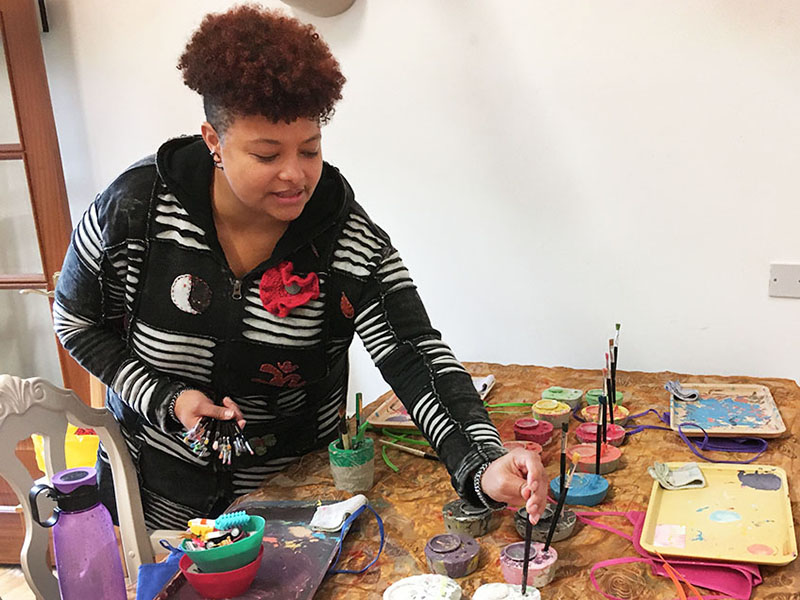 Prince's Trust award winner Natasha Graves setting up art materials for a children's workshop