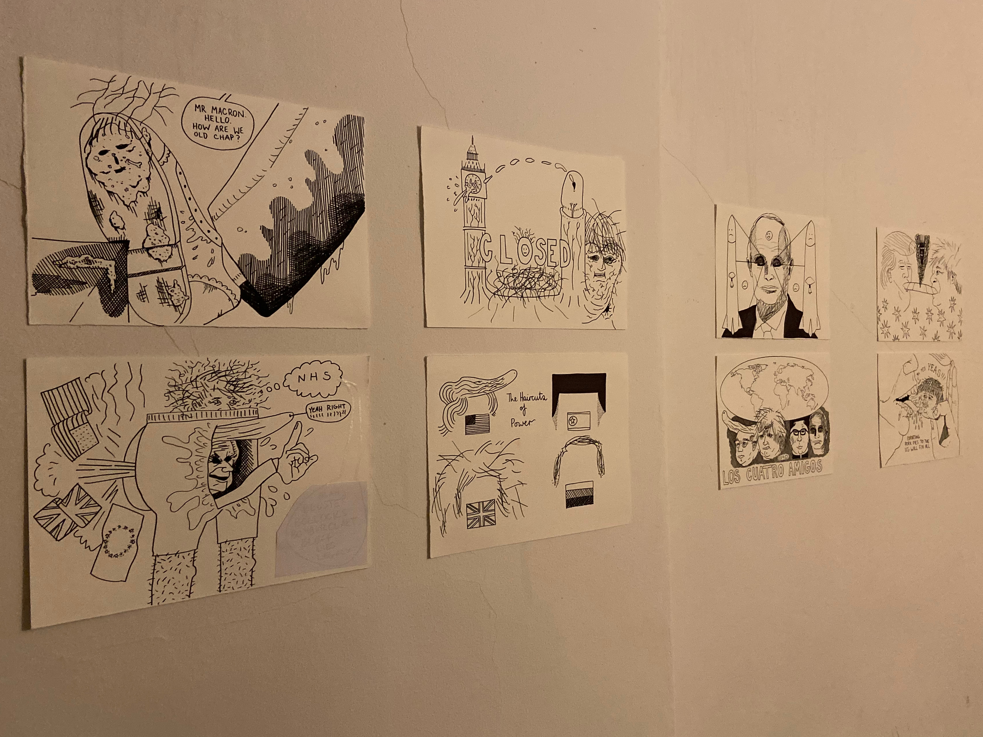 Caricatures are drawn on small pieces of paper and stuck on a toilet wall