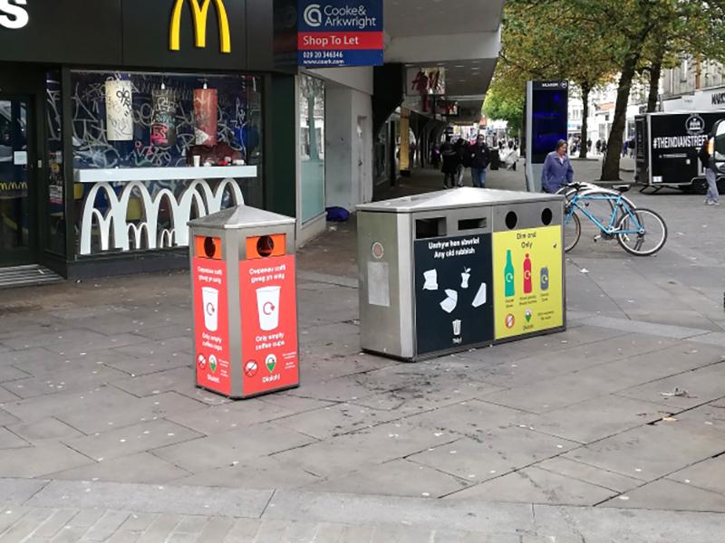 Coloured recycling bins outside McDonalds