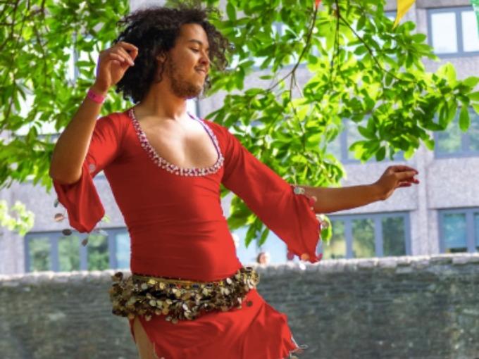 Abderrahim El Habachi in red dancing dress
