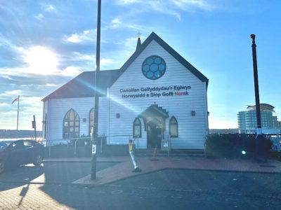 The sun shines behind the Norwegian Church Arts Centre
