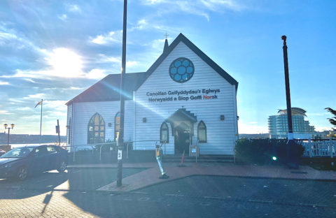 The sun shines behind the Norwegian Church Arts Centre