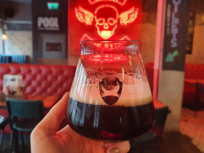 A photo of a stout beer at a bar in Cardiff