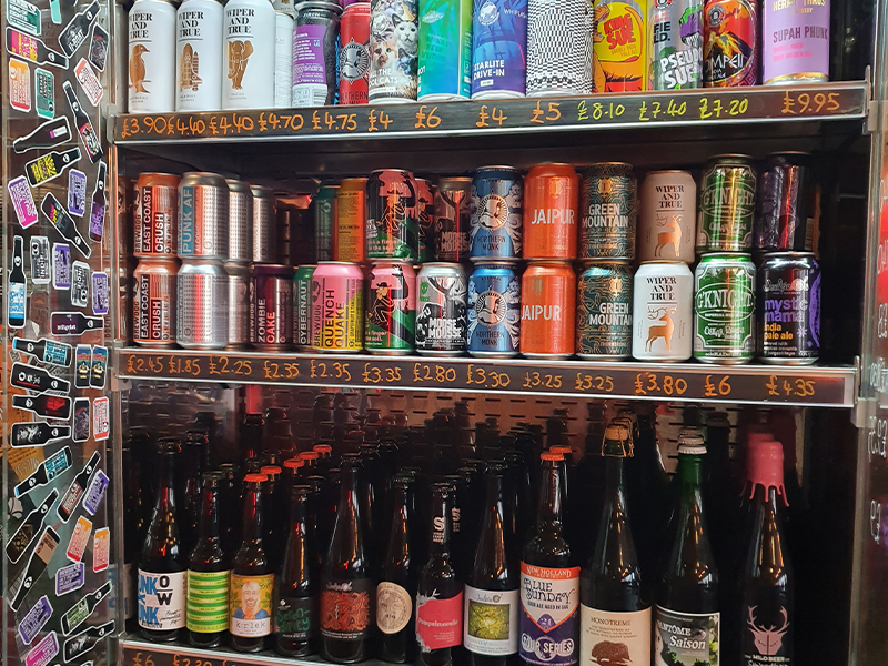 A colourful fridge filled with cans and bottles of craft beers at BrewDog in Cardiff during the Month of Darkness.