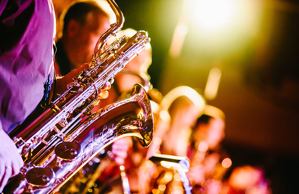 playing a saxophone at music event
