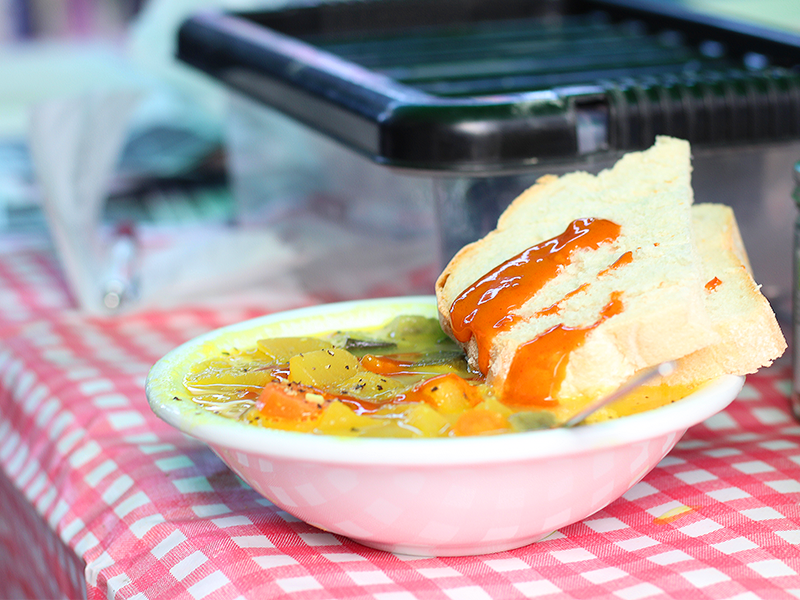 a bowl of hot soup and bread, shared on Black Friday by Green Friday activists