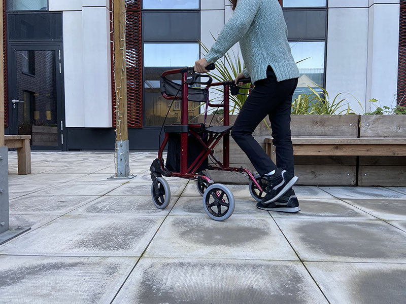 Person walking with a walking frame