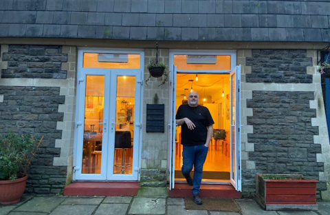 Mark Lewis stands in the open doorway of the City United Reform Church cafe
