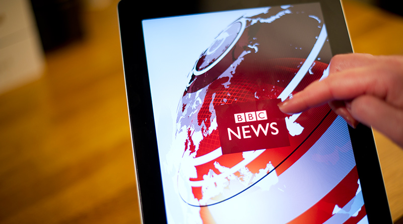 A tablet with BBC news on the screen