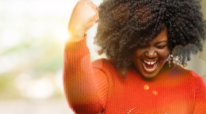 A woman expressing a winning gesture